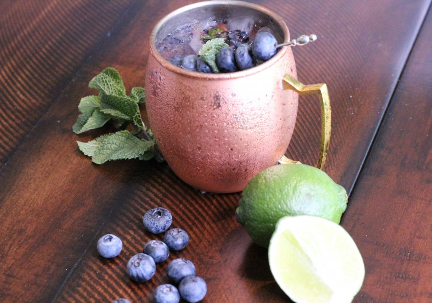 Blueberry Mule vodka drink with mint, lime, and Wish Farms blueberries